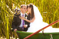 Wedding on pond bride and groom hugging in boat the lake Royalty Free Stock Image