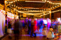 Wedding reception dance floor a long slow shutter speed was used to blur the crowd and create a sense of motion at this party in Stock Photo