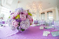 Wedding reception flower bouquet luxurious on lilac covered laid table at Royalty Free Stock Image
