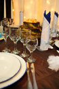 Wedding reception table with glasses and plates Royalty Free Stock Images