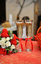 Wedding red glasses with bouquet Royalty Free Stock Photography