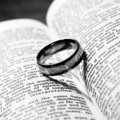 Wedding ring and bible Royalty Free Stock Photo