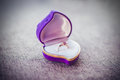Wedding ring and gift heart box Royalty Free Stock Photo