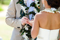 Wedding ring for her hawaiian ceremony moment where the groom places the on the brides finger Stock Photography