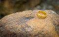 Wedding ring put on stone love concept Stock Photos