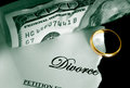 Wedding ring torn divorce decree and cash with Royalty Free Stock Image