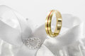 Wedding ring on white bow single golden Stock Photo
