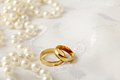 Wedding rings background with two gold Stock Images
