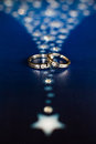 Wedding rings on a blue background Royalty Free Stock Images
