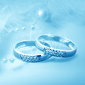 Wedding rings on blue background for card Stock Image