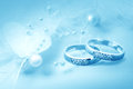 Wedding rings on blue background for card Royalty Free Stock Image