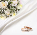Wedding rings and bouquet Stock Photography