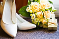 Wedding rings with bouquet and high heel shoes Royalty Free Stock Photo