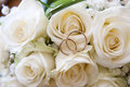 Wedding rings on a bouquet of roses Royalty Free Stock Photo