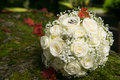 Wedding rings on bridal bouquet golden with gentle white roses Royalty Free Stock Photo
