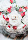 Wedding rings on the bridal bouquet photo of Stock Photo