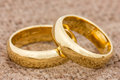 Wedding rings on the burlap pair of golden Stock Photography