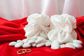 Wedding rings and favors on elegant fabric background Royalty Free Stock Photos
