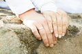 Wedding rings on the fingers of the bride and groom Royalty Free Stock Photography