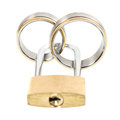 Wedding rings and key lock over white Stock Photography