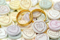 Wedding rings and Loveheart candy sweets Royalty Free Stock Images