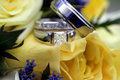 Wedding rings over bouquet Royalty Free Stock Image
