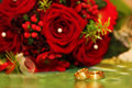 Wedding rings and red roses Royalty Free Stock Photo