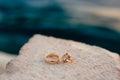 Wedding rings on the rocks near the sea Royalty Free Stock Photo
