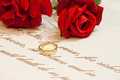 Wedding rings with roses and vows picture of Stock Photos