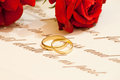 Wedding Rings with roses and vows Royalty Free Stock Photo