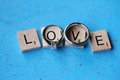 Wedding Rings on Scrabble LOVE letters Royalty Free Stock Photo