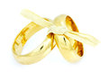 Wedding rings tied with bow two golden isolated on white background Stock Images