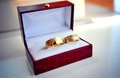 Wedding rings two golden in a fancy red box Stock Image