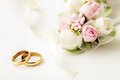 Wedding rings two golden and flowers Stock Image