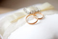 Wedding rings two on a light background Royalty Free Stock Images