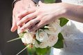 Wedding rings view of a newly married couple hands with their on top of the flowers bouquet Stock Images