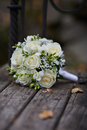 Wedding Rings and White Rose Bouquet Royalty Free Stock Photo