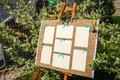 Wedding seating chart on the easel in the park. Royalty Free Stock Photo