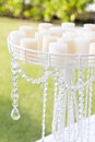 Wedding set up in garden inside beach candle and candlestick Royalty Free Stock Photo