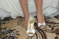 Wedding shoes with bow bride putting on on carpet at home Royalty Free Stock Photos
