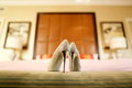 Wedding shoes on the sofa Stock Images