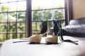 Wedding shoes on the sofa beside the window Royalty Free Stock Photos