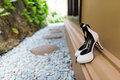 Wedding shoes beside the window Royalty Free Stock Photo