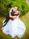 Wedding shot of bride and groom in park Stock Photo