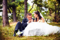 Wedding shot of bride and groom in park Stock Photography