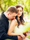 Wedding shot of bride and groom in park Royalty Free Stock Photography