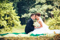 Wedding shot of bride and groom in park Royalty Free Stock Photos