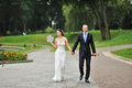 Wedding shot of bride and groom in park happy Stock Photography