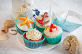 Wedding still life - cupcakes, paper boats and wine Royalty Free Stock Photo