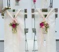 Wedding stools from behind beautiful decorated in front of the altar image taken ornaments with roses and several flowers are Stock Image